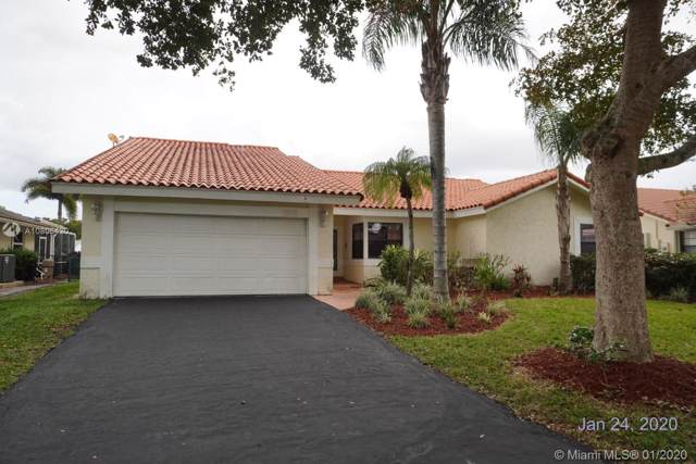 653 NW 110th Ave, Coral Springs, FL 33071 (MLS #A10806420) :: Albert Garcia Team