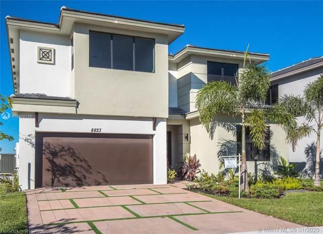 8823 NW 155, Miami Lakes, FL 33018 (MLS #A10809138) :: Berkshire Hathaway HomeServices EWM Realty
