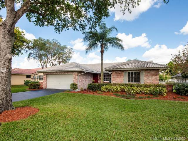 11235 NW 12th Ct, Coral Springs, FL 33071 (MLS #A10810726) :: Berkshire Hathaway HomeServices EWM Realty