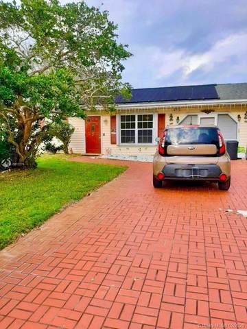1401 SE Arenson Ln, Port Saint Lucie, FL 34952 (MLS #A10813374) :: Castelli Real Estate Services