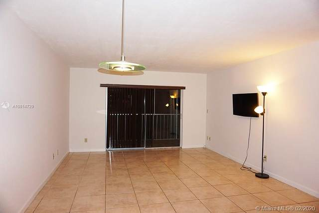 17000 NW 67th Ave #204, Hialeah, FL 33015 (MLS #A10814729) :: Grove Properties