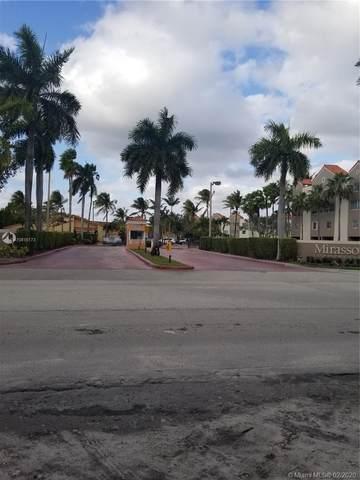 6045 NW 186th St #311, Hialeah, FL 33015 (MLS #A10815173) :: The Paiz Group