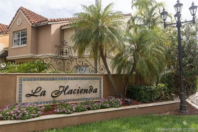 18350 NW 68th Ave I, Hialeah, FL 33015 (MLS #A10818816) :: Albert Garcia Team