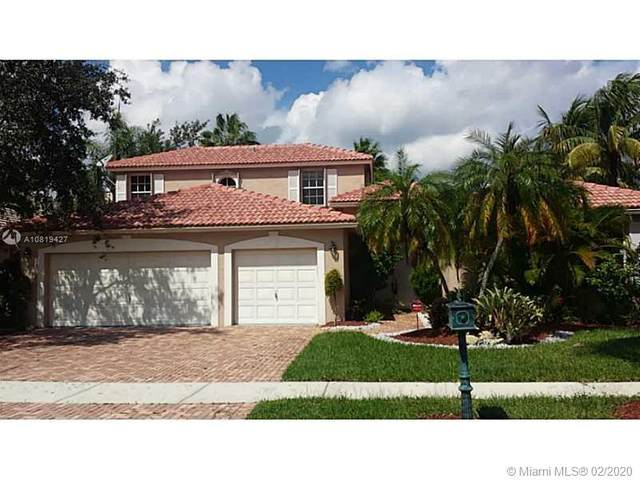 2459 Eagle Run Dr, Weston, FL 33327 (MLS #A10819427) :: The Teri Arbogast Team at Keller Williams Partners SW