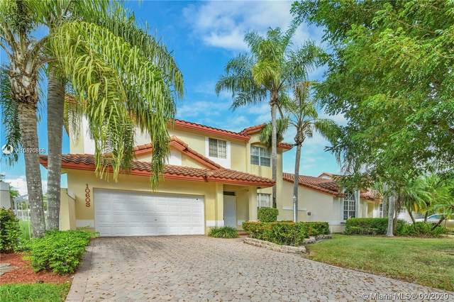 10603 NW 57th St, Doral, FL 33178 (MLS #A10820858) :: Berkshire Hathaway HomeServices EWM Realty