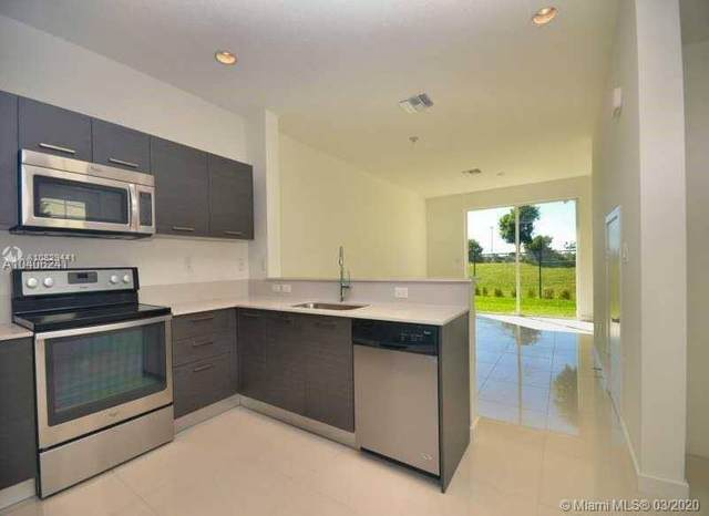 3408 NW 13th St #3408, Lauderhill, FL 33311 (MLS #A10829441) :: The Paiz Group