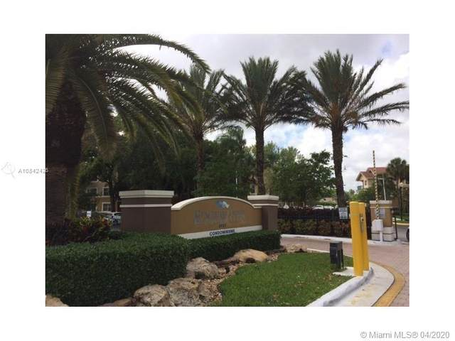 8955 Wiles Rd #306, Coral Springs, FL 33067 (MLS #A10842426) :: The Howland Group