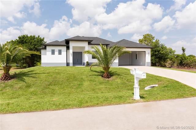 1506 Pearl Ave S, Lehigh Acres, FL 33976 (MLS #A10851556) :: Berkshire Hathaway HomeServices EWM Realty