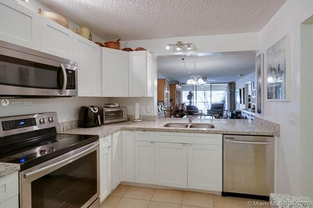 8592 W Sunrise Blvd #205, Plantation, FL 33322 (MLS #A10851664) :: Berkshire Hathaway HomeServices EWM Realty