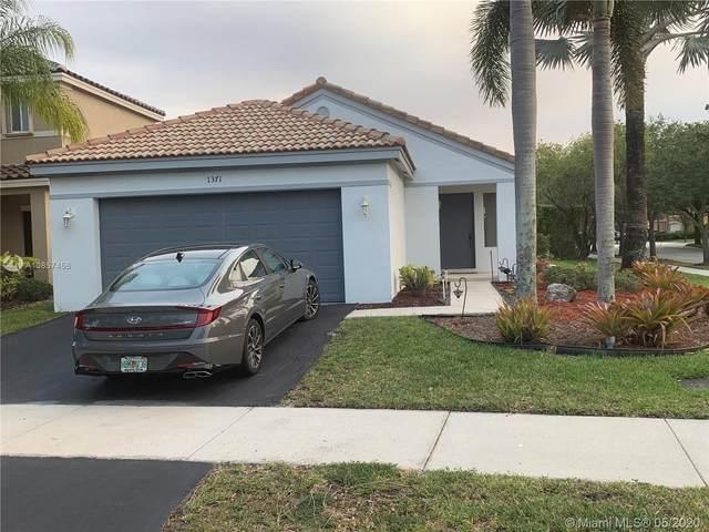 1371 Sabal Trl, Weston, FL 33327 (MLS #A10857456) :: The Teri Arbogast Team at Keller Williams Partners SW