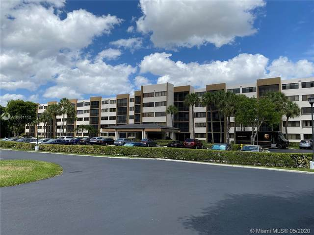 9735 NW 52nd St #201, Doral, FL 33178 (MLS #A10861112) :: Miami Villa Group