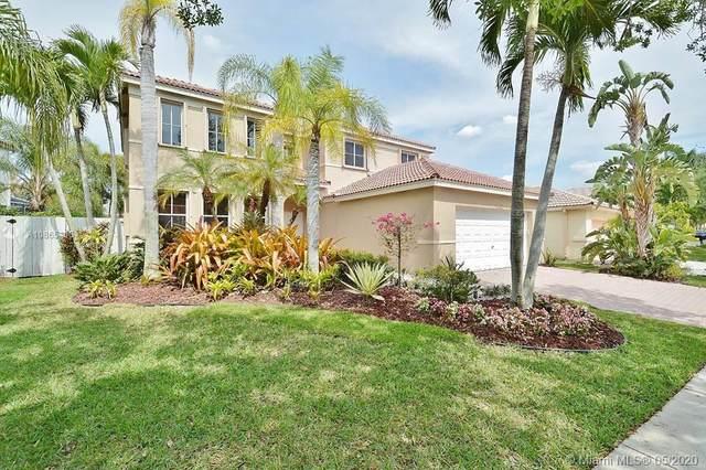 1449 Meadows Blvd, Weston, FL 33327 (MLS #A10865406) :: The Teri Arbogast Team at Keller Williams Partners SW