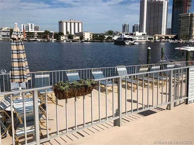 300 Golden Isles Dr #117, Hallandale Beach, FL 33009 (MLS #A10865959) :: Castelli Real Estate Services