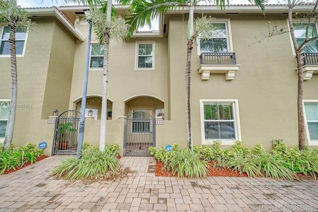 2851 W Prospect Rd #208, Tamarac, FL 33309 (MLS #A10865973) :: Grove Properties
