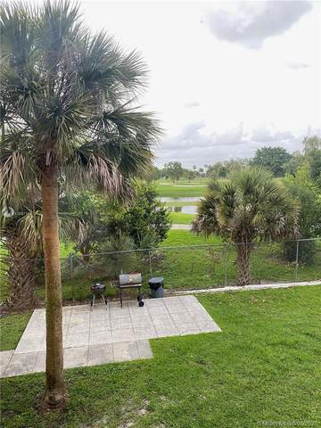 7075 NW 186th St C205, Hialeah, FL 33015 (MLS #A10867166) :: GK Realty Group LLC