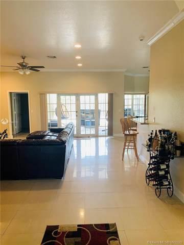 5202 SW 11th St, Plantation, FL 33317 (MLS #A10868212) :: Berkshire Hathaway HomeServices EWM Realty