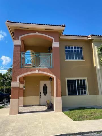 6960 NW 174th Ter #702, Hialeah, FL 33015 (MLS #A10869189) :: Berkshire Hathaway HomeServices EWM Realty