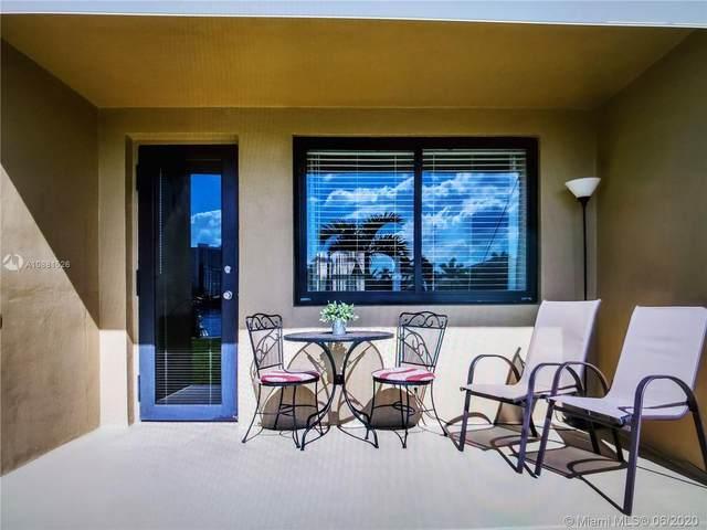 301 Golden Isles Dr #104, Hallandale Beach, FL 33009 (MLS #A10881526) :: Castelli Real Estate Services