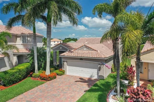 4255 Magnolia Ridge Dr, Weston, FL 33331 (MLS #A10883703) :: Berkshire Hathaway HomeServices EWM Realty