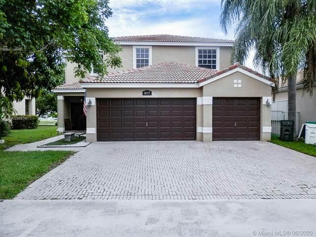 4017 NW 62nd Dr, Coconut Creek, FL 33073 (MLS #A10883917) :: Berkshire Hathaway HomeServices EWM Realty