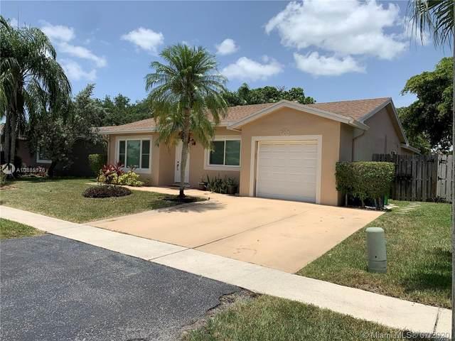 9365 NW 53rd Ct, Sunrise, FL 33351 (MLS #A10885176) :: Berkshire Hathaway HomeServices EWM Realty