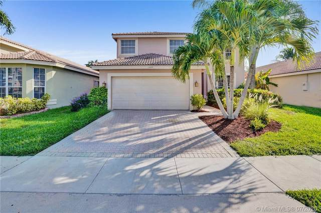 11869 NW 53rd Ct, Coral Springs, FL 33076 (MLS #A10886719) :: Laurie Finkelstein Reader Team
