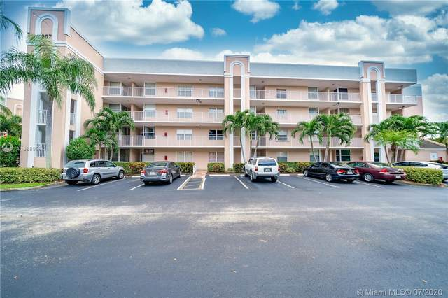 10382 NW 24th Pl #102, Sunrise, FL 33322 (MLS #A10889584) :: Berkshire Hathaway HomeServices EWM Realty