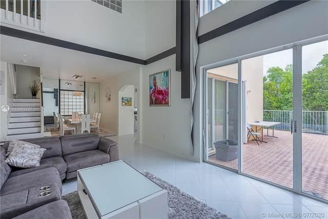 975 Corkwood St, Hollywood, FL 33019 (MLS #A10892247) :: Berkshire Hathaway HomeServices EWM Realty