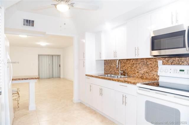1950 W 54th St #205, Hialeah, FL 33012 (MLS #A10898510) :: Grove Properties