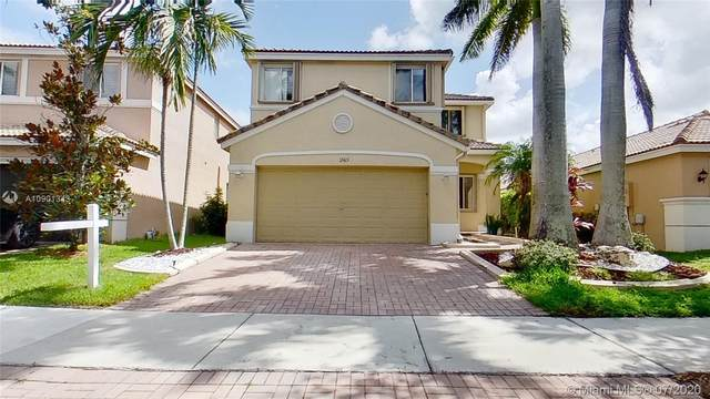 1365 Canary Island Dr, Weston, FL 33327 (MLS #A10901343) :: The Teri Arbogast Team at Keller Williams Partners SW