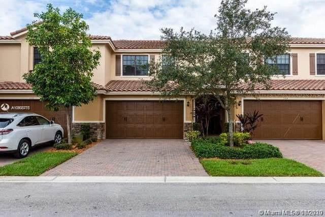 102 E Riverwalk Cir E #102, Plantation, FL 33325 (MLS #A10903413) :: Berkshire Hathaway HomeServices EWM Realty