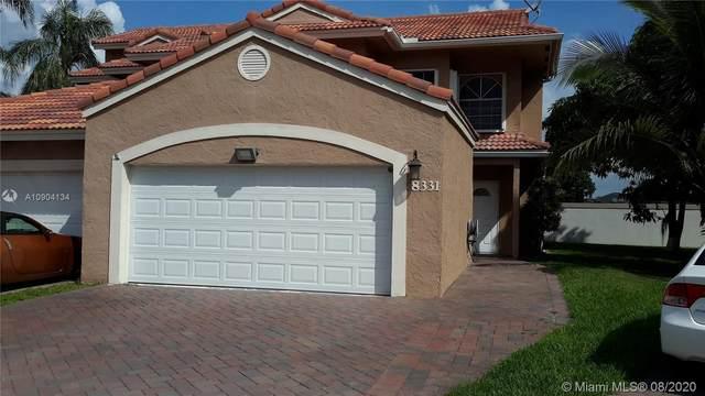 8331 NW 191st Ln 4R, Hialeah, FL 33015 (MLS #A10904134) :: Berkshire Hathaway HomeServices EWM Realty