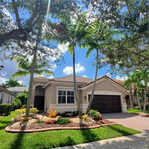 710 Conservation Dr, Weston, FL 33327 (MLS #A10905286) :: The Teri Arbogast Team at Keller Williams Partners SW