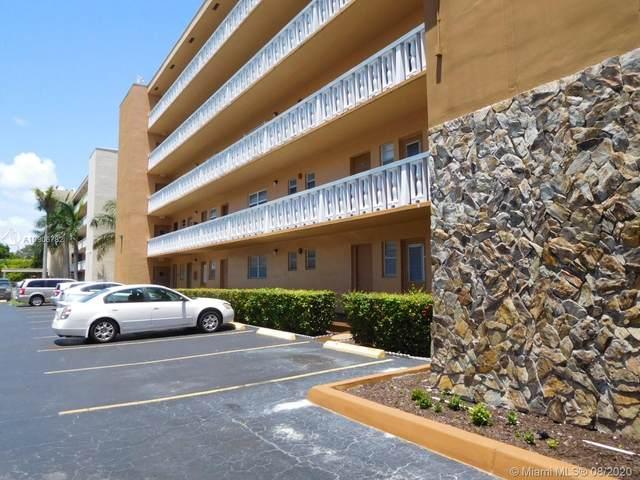 219 NE 14th Ave #206, Hallandale Beach, FL 33009 (MLS #A10906782) :: Berkshire Hathaway HomeServices EWM Realty