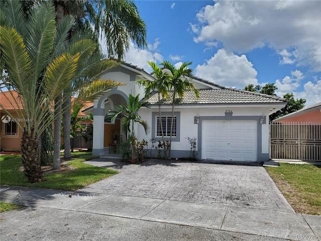 8786 NW 142nd St, Miami Lakes, FL 33018 (MLS #A10907463) :: The Howland Group