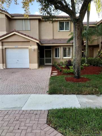 5658 NW 125th Ave, Coral Springs, FL 33076 (MLS #A10908739) :: The Teri Arbogast Team at Keller Williams Partners SW