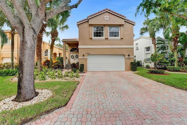 11457 NW 49th Dr, Coral Springs, FL 33076 (MLS #A10910320) :: The Teri Arbogast Team at Keller Williams Partners SW