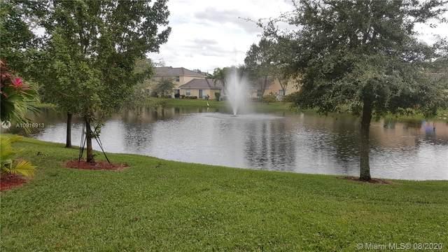8940 NW 53rd Ct, Sunrise, FL 33351 (MLS #A10916913) :: Berkshire Hathaway HomeServices EWM Realty