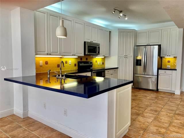 10720 NW 66th St #409, Doral, FL 33178 (MLS #A10922957) :: Carole Smith Real Estate Team