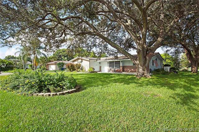 3690 NW 100th Ave, Coral Springs, FL 33065 (MLS #A10929162) :: Laurie Finkelstein Reader Team