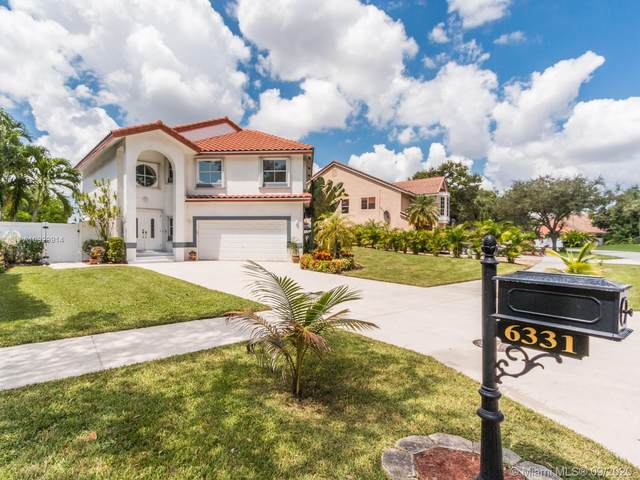 6331 NW 57th Way, Parkland, FL 33067 (MLS #A10929914) :: United Realty Group