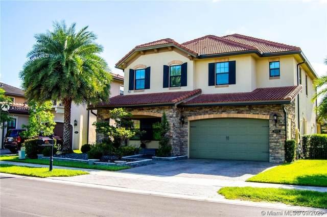 9125 Carrington Ave, Parkland, FL 33076 (MLS #A10932739) :: Carole Smith Real Estate Team