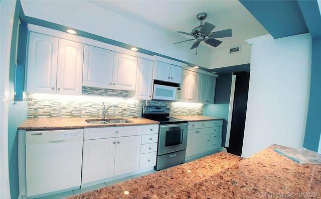 462 Golden Isles Dr #210, Hallandale Beach, FL 33009 (MLS #A10936863) :: Berkshire Hathaway HomeServices EWM Realty