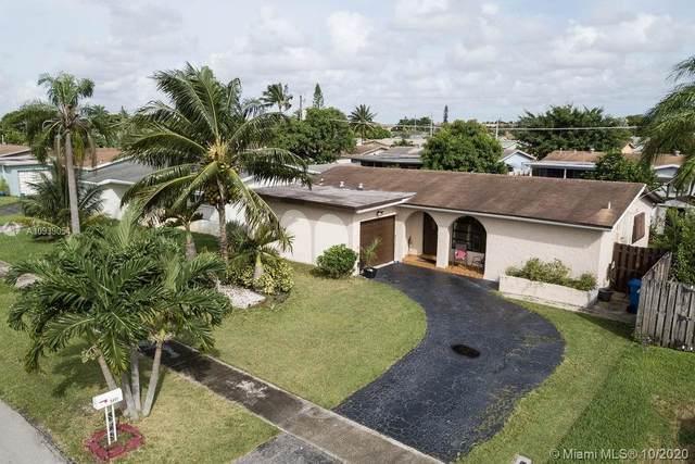 9451 NW 24th Pl, Sunrise, FL 33322 (MLS #A10939054) :: Berkshire Hathaway HomeServices EWM Realty