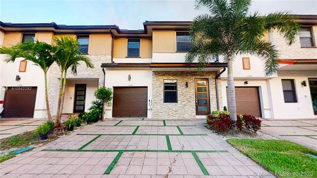 15585 NW 91st Ct ., Miami Lakes, FL 33018 (MLS #A10942292) :: Berkshire Hathaway HomeServices EWM Realty