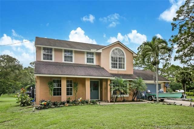 14616 N 62nd Ct N, Loxahatchee, FL 33470 (MLS #A10943935) :: Berkshire Hathaway HomeServices EWM Realty