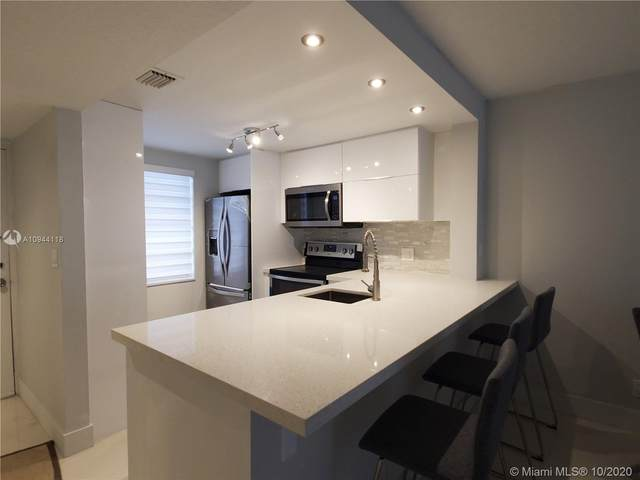 6190 Woodlands Blvd #518, Tamarac, FL 33319 (MLS #A10944118) :: Green Realty Properties