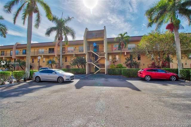 1100 Crystal Lake Dr #202, Deerfield Beach, FL 33064 (MLS #A10947373) :: Berkshire Hathaway HomeServices EWM Realty