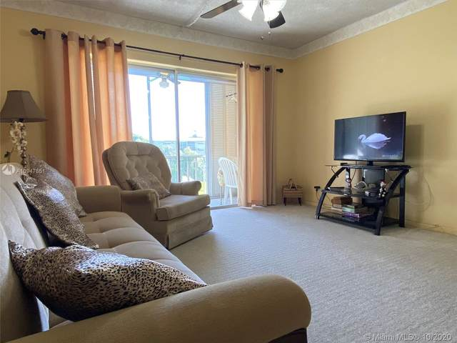 5200 Washington St #202, Hollywood, FL 33021 (MLS #A10947651) :: Berkshire Hathaway HomeServices EWM Realty