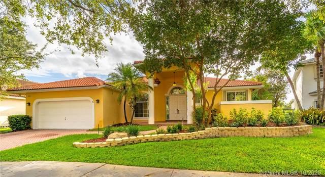 2803 Oakbrook Dr, Weston, FL 33332 (MLS #A10947894) :: Search Broward Real Estate Team at RE/MAX Unique Realty